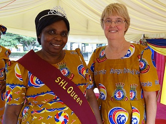 Commissioner Silvia Cox shares a moment with a Salvationist at a women's rally in Dar es Salaam