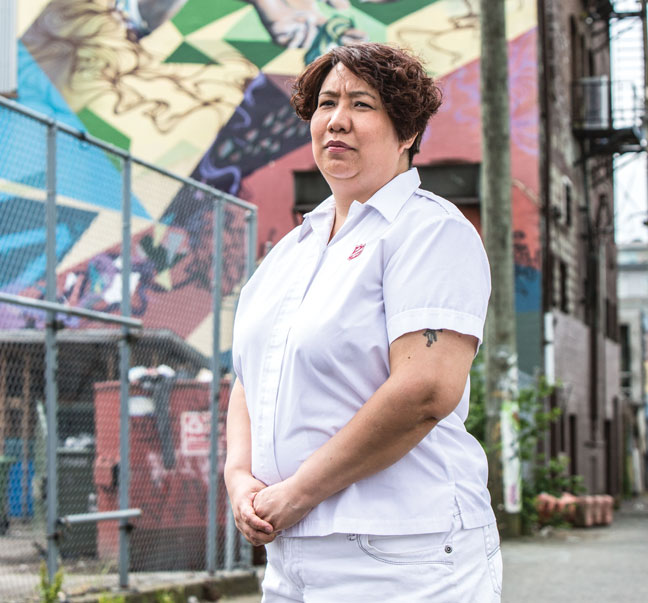 Jennifer Allan, the first Indigenous soldier at 614 Corps in Vancouver, stands beside the Astoria Hotel in the Downtown Eastside, where many survival sex workers went missing (Photos: Kim Stallknecht)