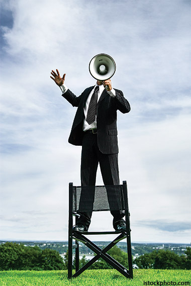 Photo of man with megaphone to illustrate the need for a spiritual wake up call