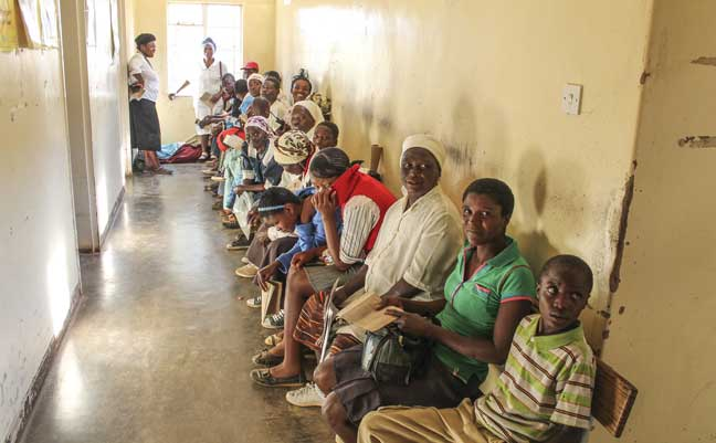 People wait to see doctors in the out-patient department. Many travel for quite a distance to access the medical services provided by the hospital
