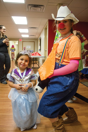 Brianna Mulder and Kaitlin Valentino show off their costumes at a special Halloween edition of Messy Church