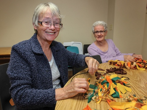 Linda Sutherland and Janice Wilson make seasonal wreaths at SA Connections