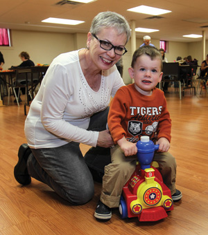 Carolyn Barnett and her great-nephew, Quinn, play together at SA Connections