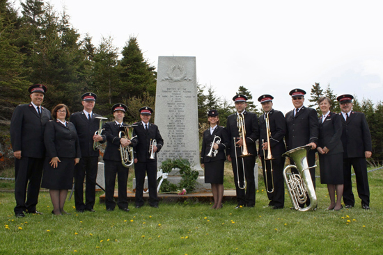 Colonel Mark Tillsley, chief secretary; Colonel Sharon Tillsley, territorial secretary for women's ministries; members of the Canadian Staff Band; Majors Anne and Brian Venables, divisional director of women's ministries and divisional commander, Quebec Division, gather at the Canadian Pacific Monument in Rimouski, Quebec