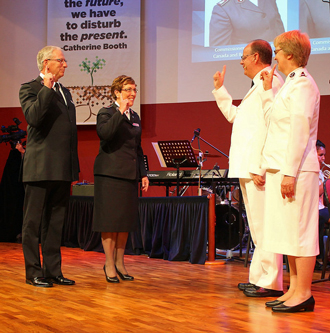 Commissioners Brian and Roaslie Peddle salute international leaders, General André Cox and Commissioner Silvia Cox (World President of Women's Ministries) at the International Conference of Leaders 2014