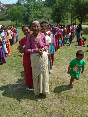 The Salvation Army distributes food to those in need at a golf course camp in Nepal
