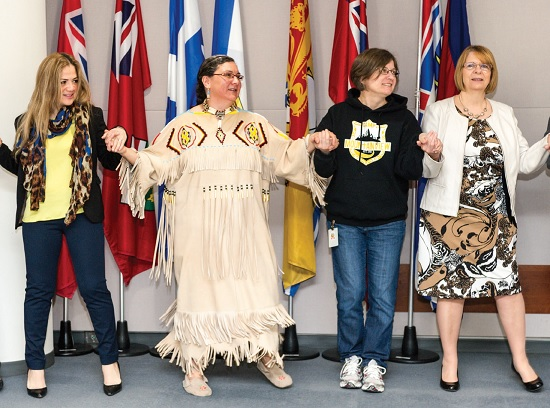 Mjr Shari Russell leads a round dance at a chapel service at territorial headquarters in April