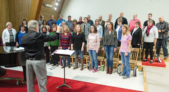 Major Len Ballantine leads the Canadian Staff Songsters in rehearsal