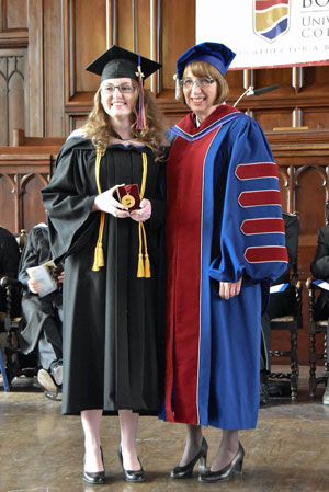 Commissioner Susan McMillan awards Emma Gerard with the Chancellor's Medal