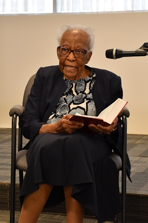 One-hundred-and-three-year-old Salvationist Una Adams reads from Ephesians