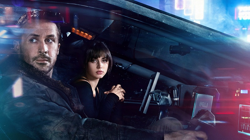 Officer K (Ryan Gosling) enlists Joi (Ana de Armas) to help him with a long-buried past