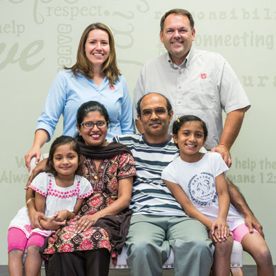 """God has used Julie and Terry (back) to help us during this part of our lives,"" says Cheryl Alvares, with husband, Jason, and daughters Hannah and Abigail"