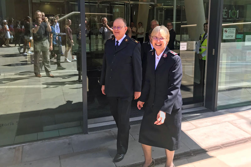 General André Cox and Commissioner Silvia leave IHQ for the final time as international leaders