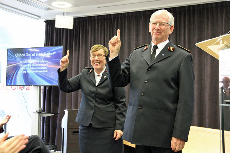 General Brian Peddle and Commissioner Rosalie Peddle take the salute