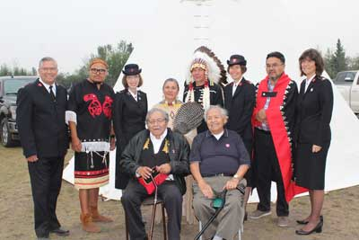 Photo of Commissioner Susan McMillan and members of cabinet with Indigenous leaders