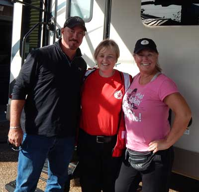 Photo of Linda Leigh with hurricane victims Rick and Sherri