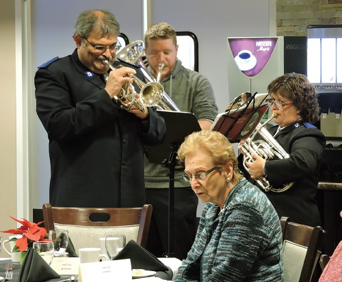 A group of Salvation Army members play music