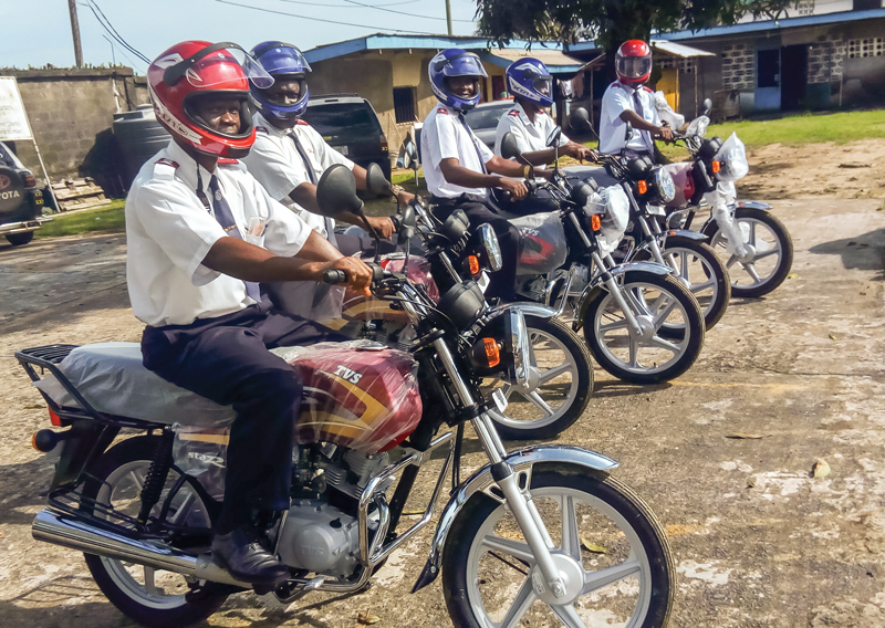Salvation Army officers at the headquarters of the Liberia Cmd receive donated motorbikes