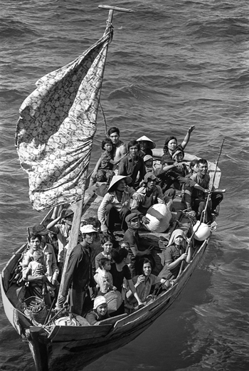 Vietnamese boat people are rescued by the U.S. Navy near Cam Ranh Bay, Vietnam