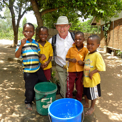 Commissioner Brian Peddle, then territorial commander for Canada and Bermuda, visits with children at a Salvation Army project in Malawi during a Partners in Mission trip