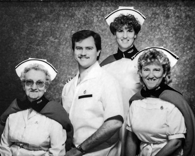 The family posed together with Mrs. Brg Ada Oakley in the early 1990s for this group photo