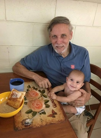 Major Bill Barthau spends time with his granddaughter, Hadassah