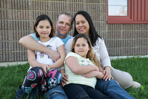"""It's more than a church; it's a community,"" says Remko van Rhijn, with his wife, Ning, and their daughters Lianna and Tala"