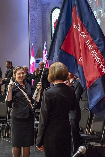 Cdt Alecia Barrow carries the sessional flag