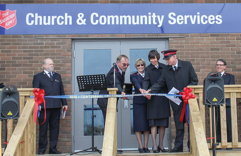 Cpts Ben and Isobel Lippers; Mjr Margaret McLeod; and Lt-Col Fred Waters, TSBA, cut the ribbon