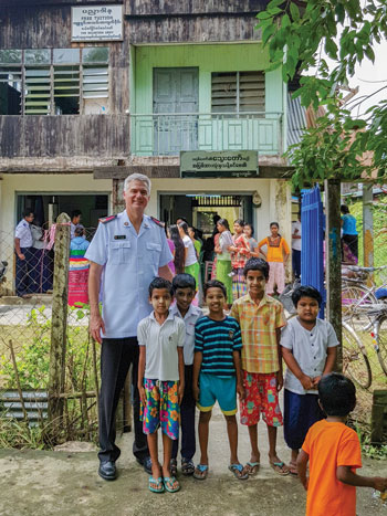 Colonel Edward Hill engages in ministry in Dallah, Myanmar