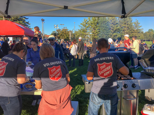Salvationists serve food at a park in Barrhaven