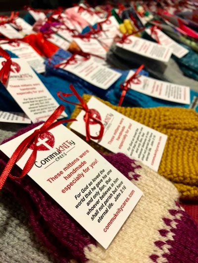 CommuKNITy Cares scarves with handwritten notes attached