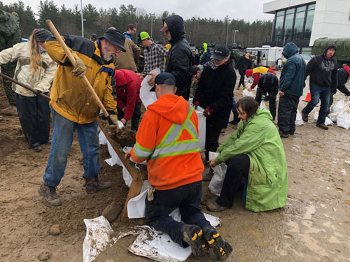 Volunteers work together to make sandbags in Ottawa