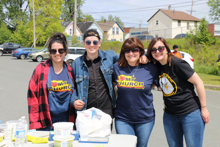 A group of four block party volunteers
