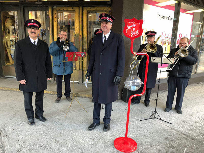 Colonel Edward Hill, chief secretary, rings the kettle bells in Montreal