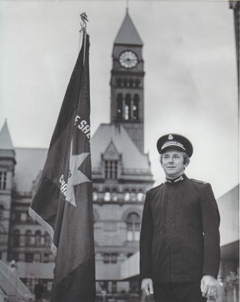 Major Norman Bearcroft stands near city hall in Toronto