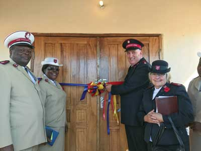 t, Cols Moses and Sarah Wandulu, TC and TPWM, Malawi Tty, and Mjrs Ron and Toni Cartmell, then DC and DDWM, Alta. & N.T. Div, cut the ribbon for the new corps in Monkey Bay, Malawi