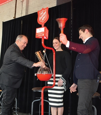 Tessa Virtue and Scott Moir ring the kettle bells at The Salvation Army's Hope in the City event in Victoria in December 2018.