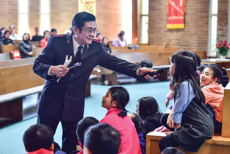 Aux-Cpt Parker Shieh leads an interactive children's time during a Sunday morning meeting
