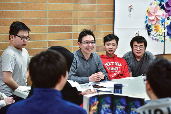 Edison Shieh leads a discussion with members of the youth group