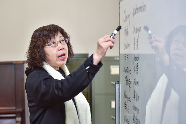 Leng-Ya Peng teaches ESL using a white board
