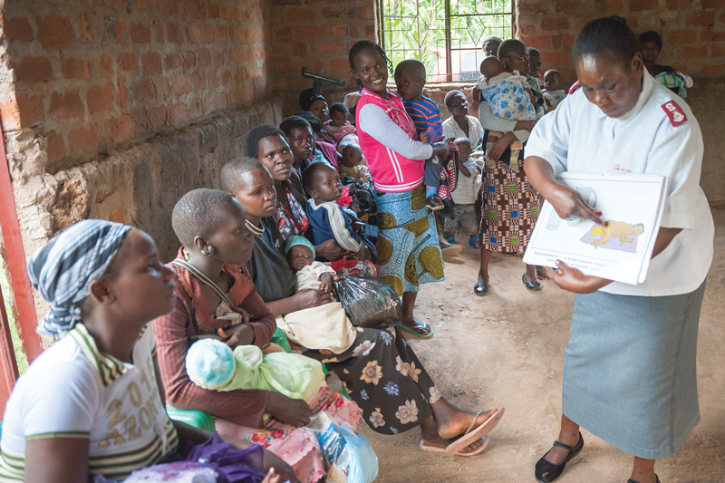 A Salvation Army officer shares a lesson on mother and child health in the Kenya West Tty