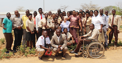 Photo of  Mjr Donna Barthau with staff and students, including Vernon, from Chaanga Secondary School in Zambia
