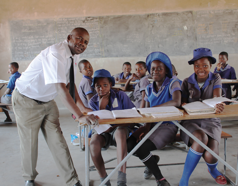The headmaster with students at Seula Primary School in Zimbabwe