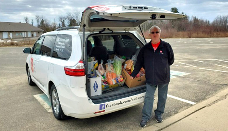 Salvation Army team member delivering food in Fredericton.