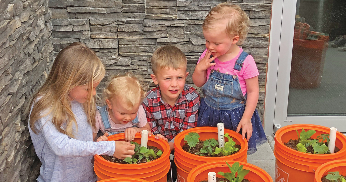Children check out the bucket gardens available for free at The Salvation Army's Renew Church