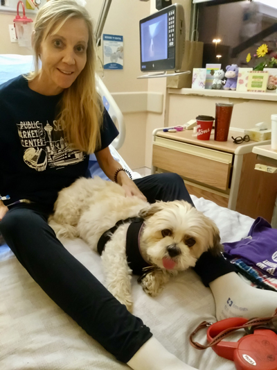 Cindy gets a visit from her therapy dog, Spencer, at North York General Hosptal