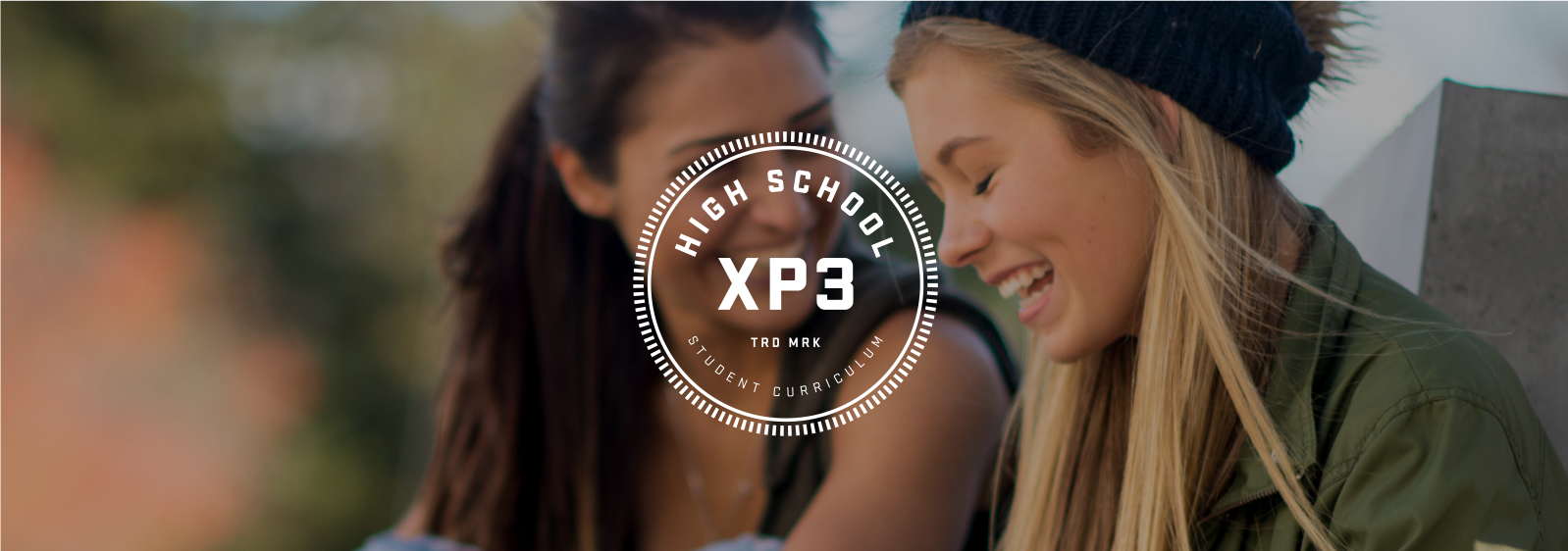 XP3 High School Curriculum logo, with two girls laughing in the background