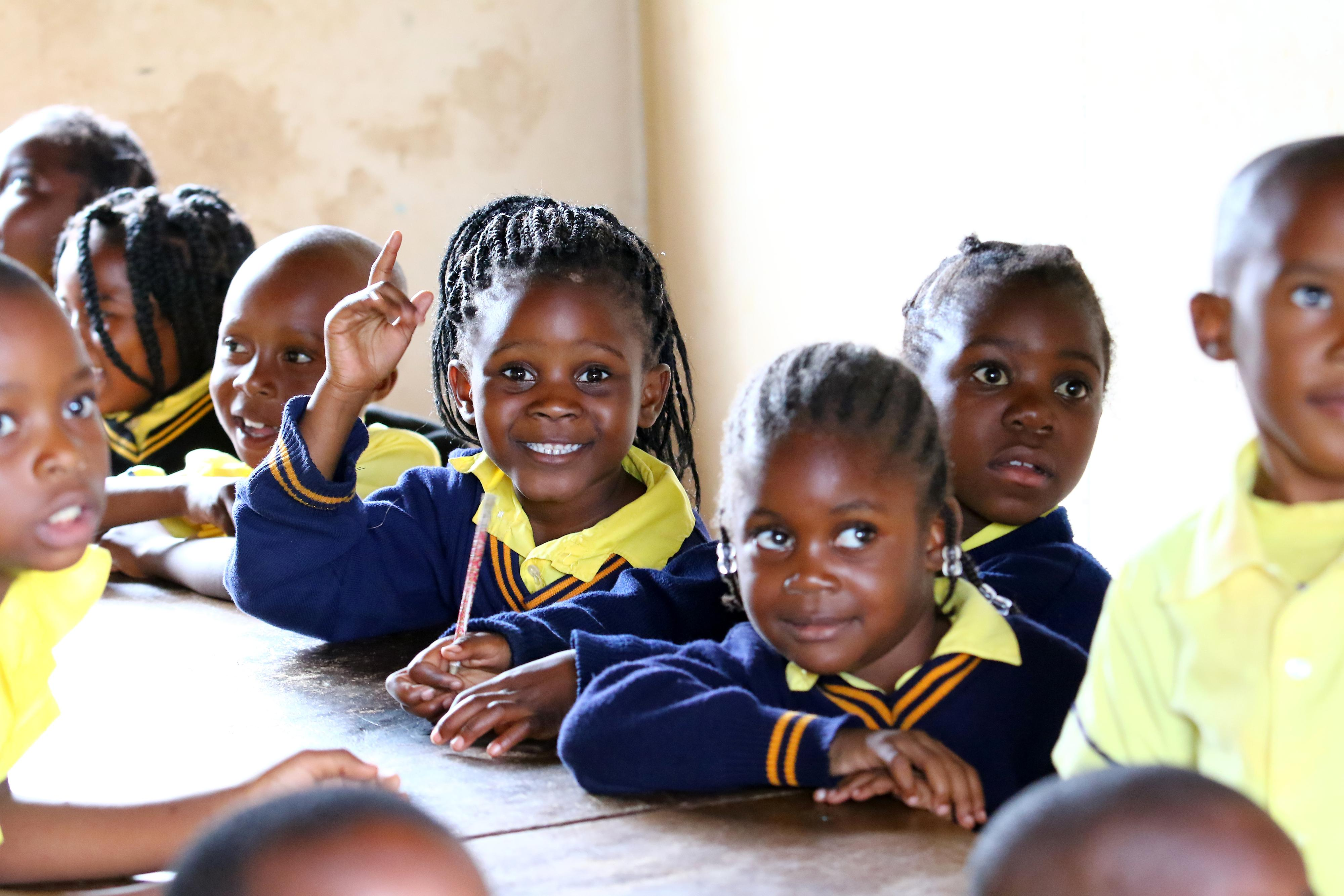 Photo of smiling school children in Zambia